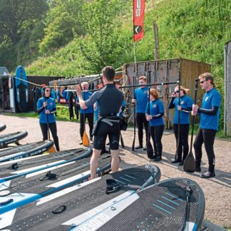 Courier Features - Out and About - Gayle Ritchie story; CR0012149 Gayle goes paddleboarding at new venture in Stonehaven.  Picture Shows; instructor, Angus Jacobs and the class, Old Pier, Stonehaven Harbour, Stonehaven, 26th July 2019. Pic by Kim Cessford / DCT Media